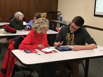 "UAHS Computer Science Club reaches out to residents at ""Teen Tech Help"" events"