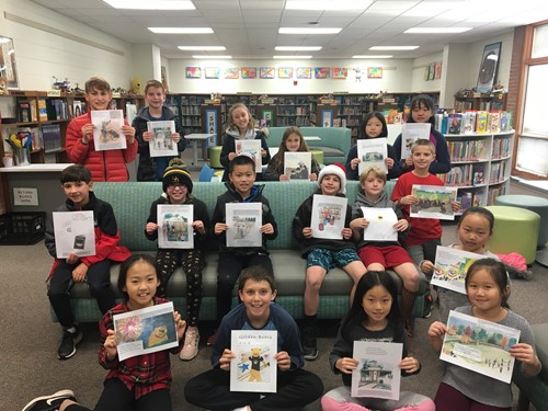 Students from the editing team for Golden Bears A to Z holding up sample pages