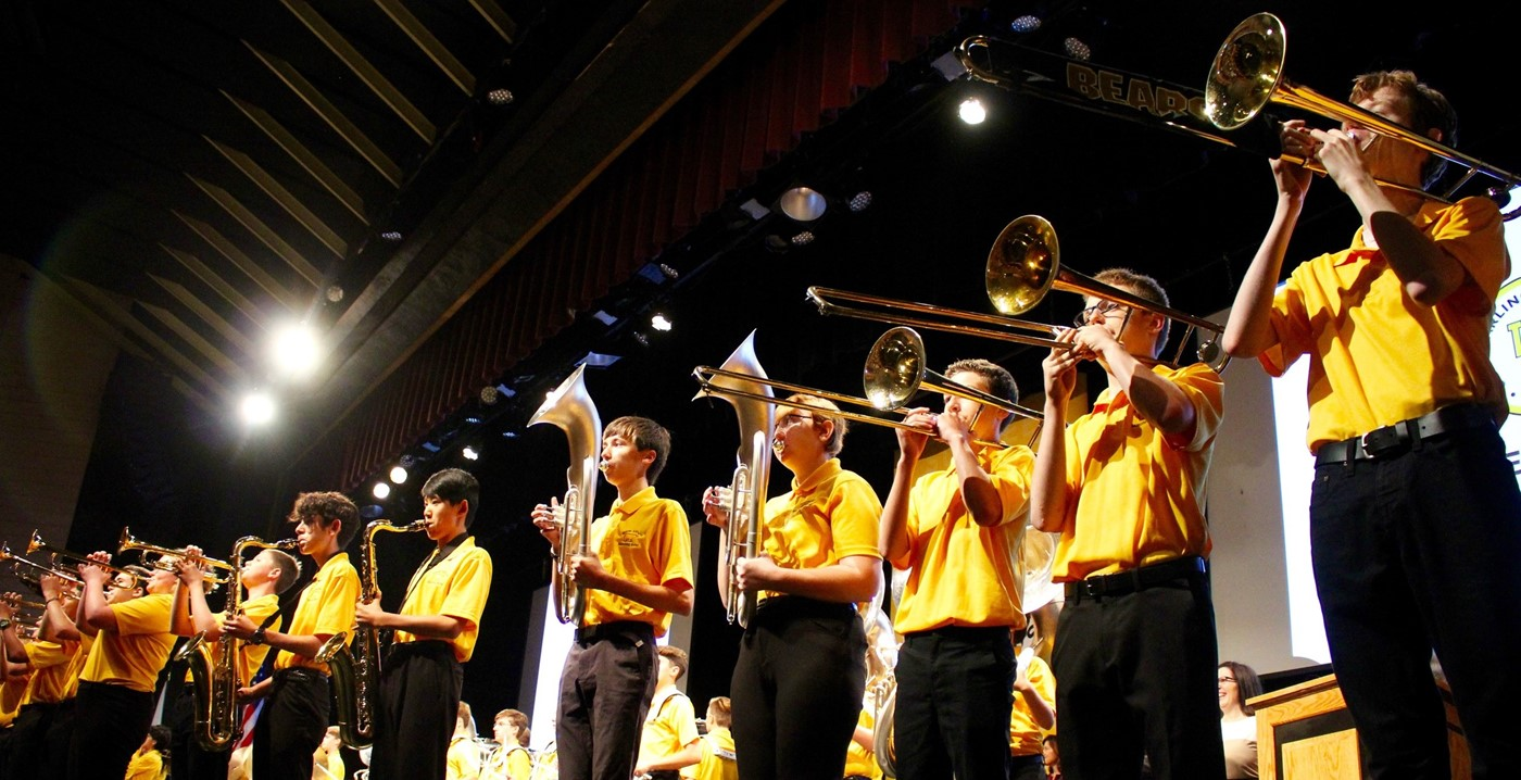 The UAHS Marching Band performing in the auditorium