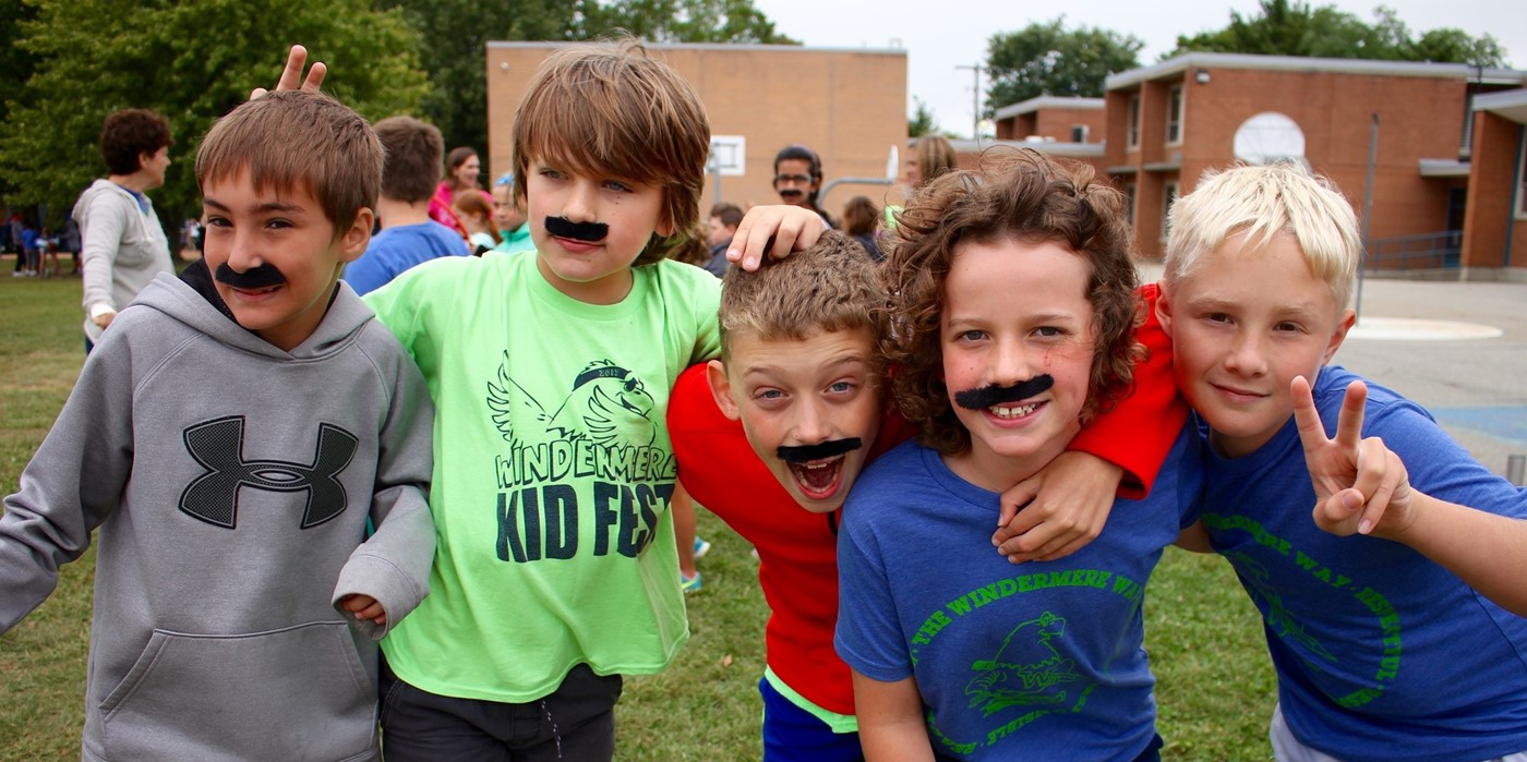 Five boys in Windermere gear and mustaches