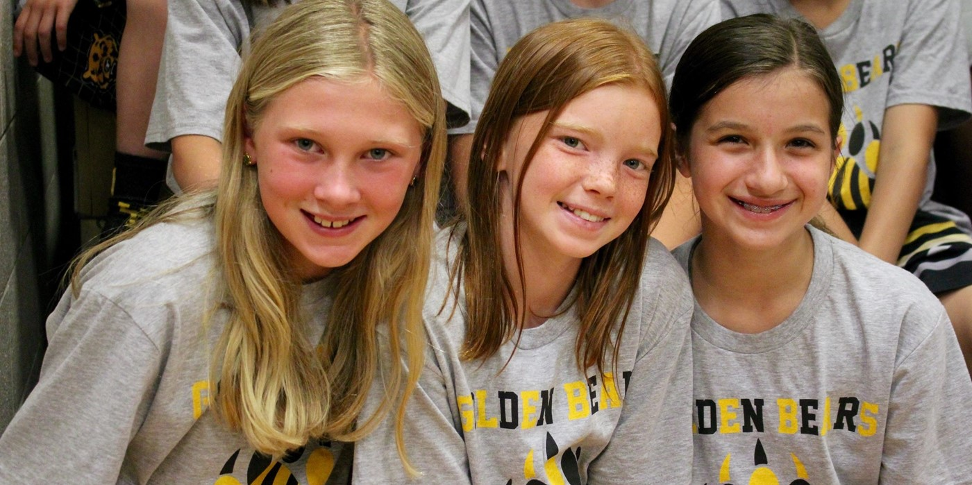 Three girls smiling in Golden Bears shirts