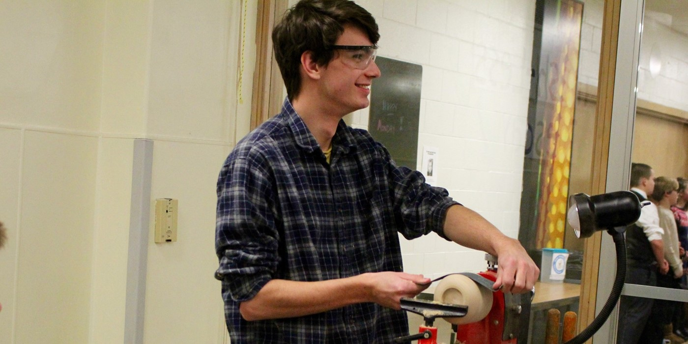 A student showing woodworking at State of the Schools