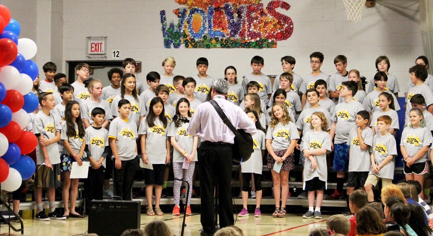 Chris Collaros playing guitar at 5th grade graduation, 2018