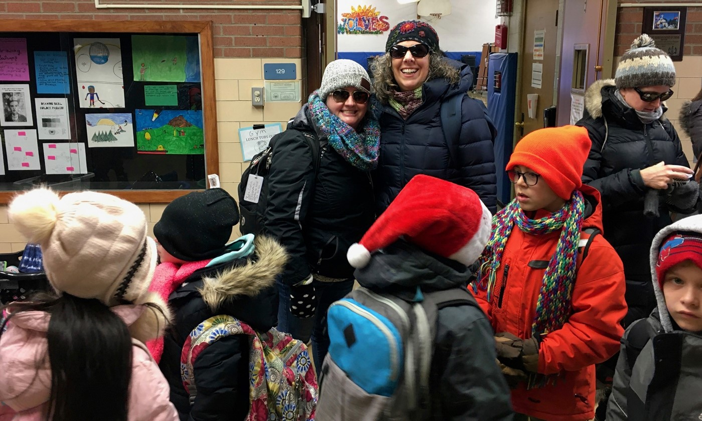 Mrs. Coplin and Mrs. Pilutti getting ready for a field trip