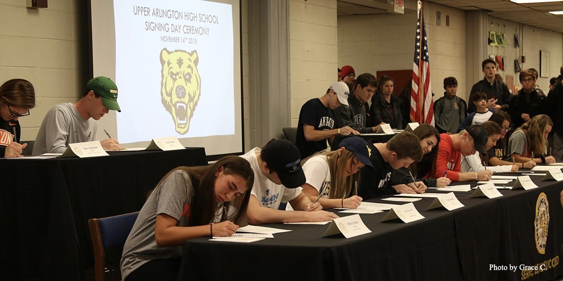Students singing college athletic scholarships