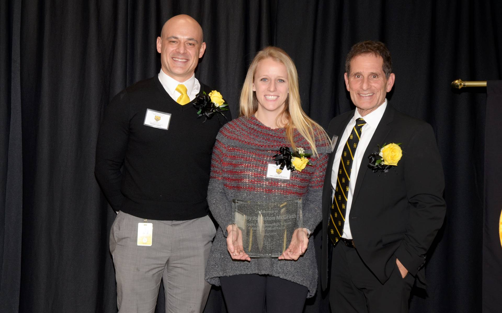 Inductee Abby Johnston McGrath with Principal Andrew Theado and Athletic Director Tony Pusateri