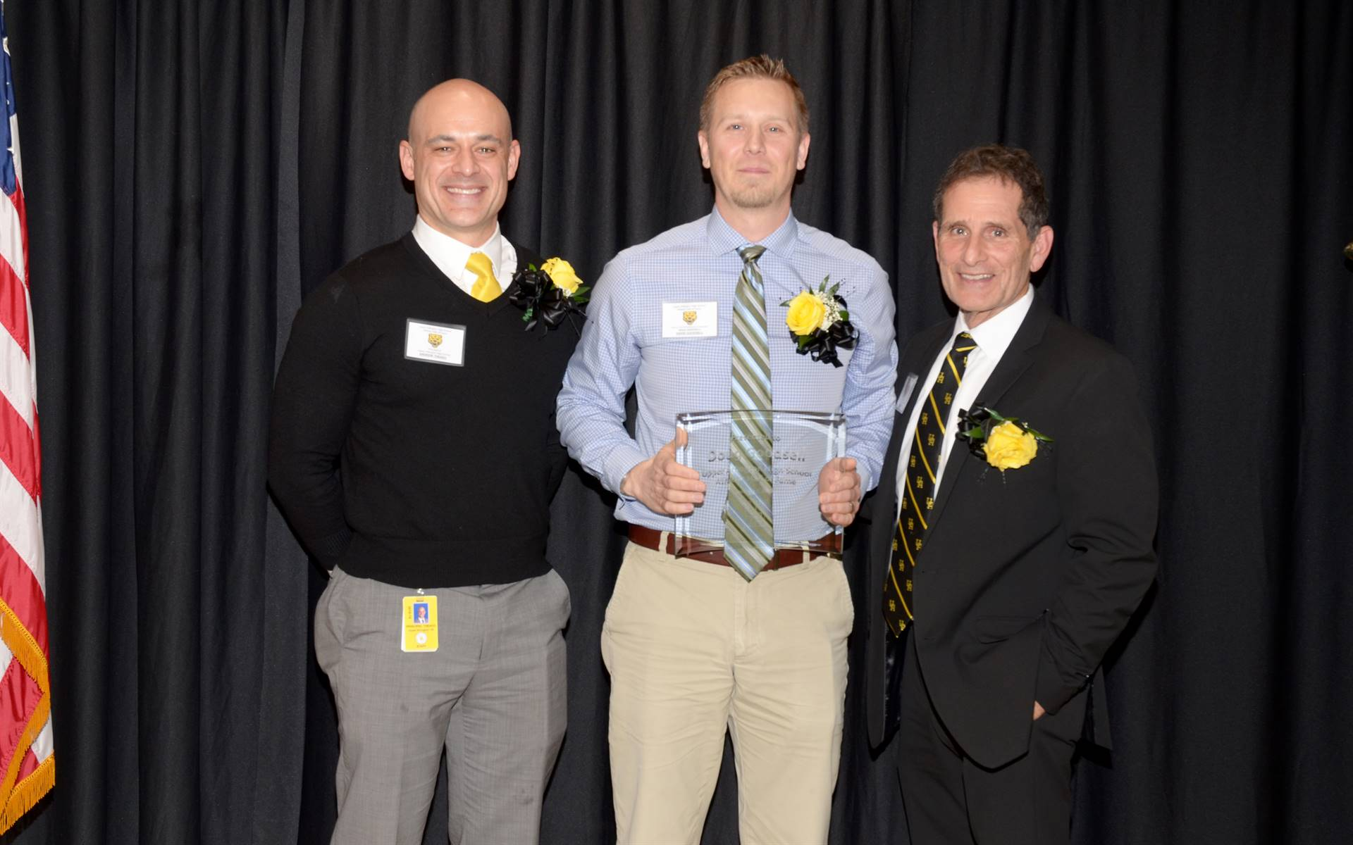 The son of inductee Doug Goodsell with Principal Andrew Theado and Athletic Director Tony Pusateri