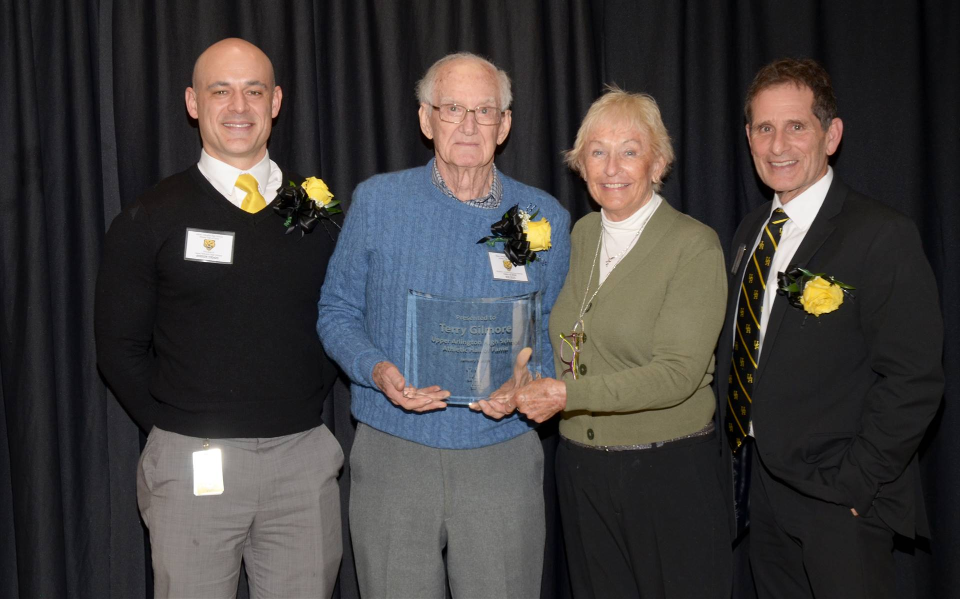 The family of inductee Terry Gilmore with Principal Andrew Theado and Athletic Director Tony Pusater