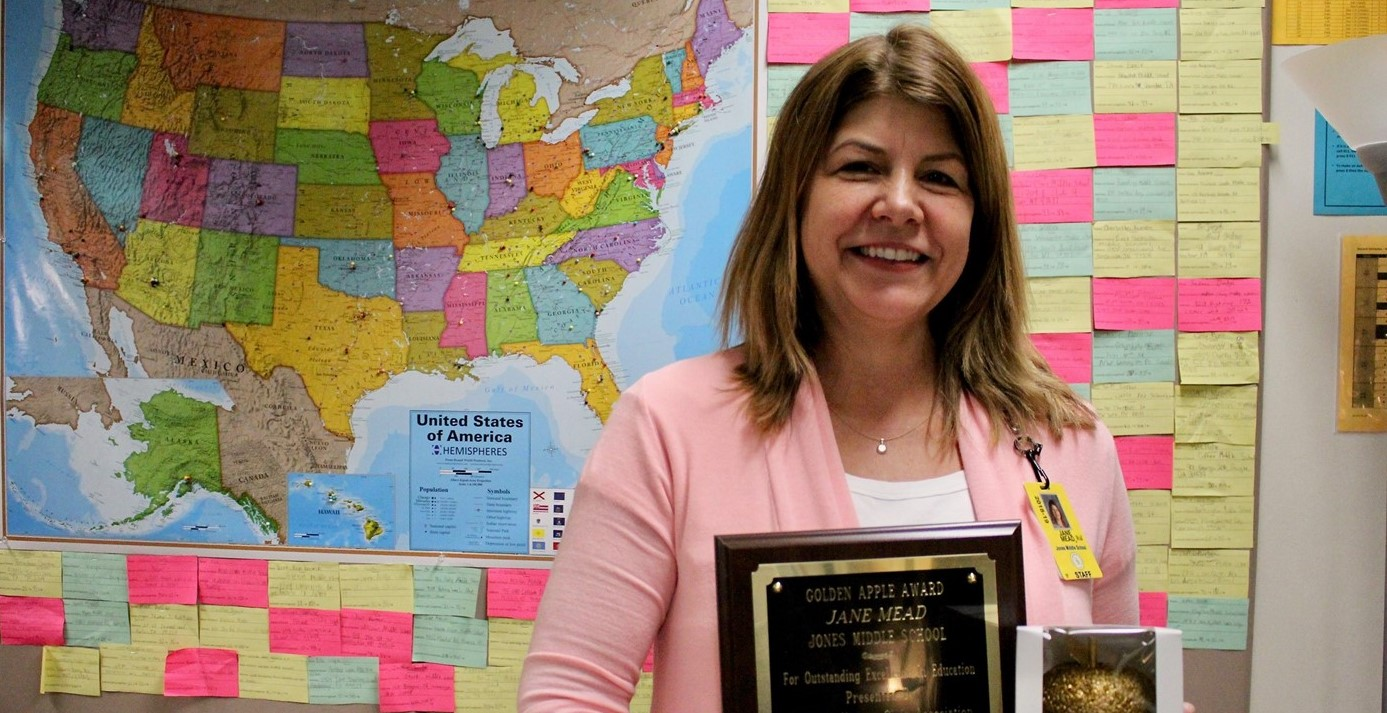 School Nurse Jane Mead receiving the 2019 Golden Apple Award
