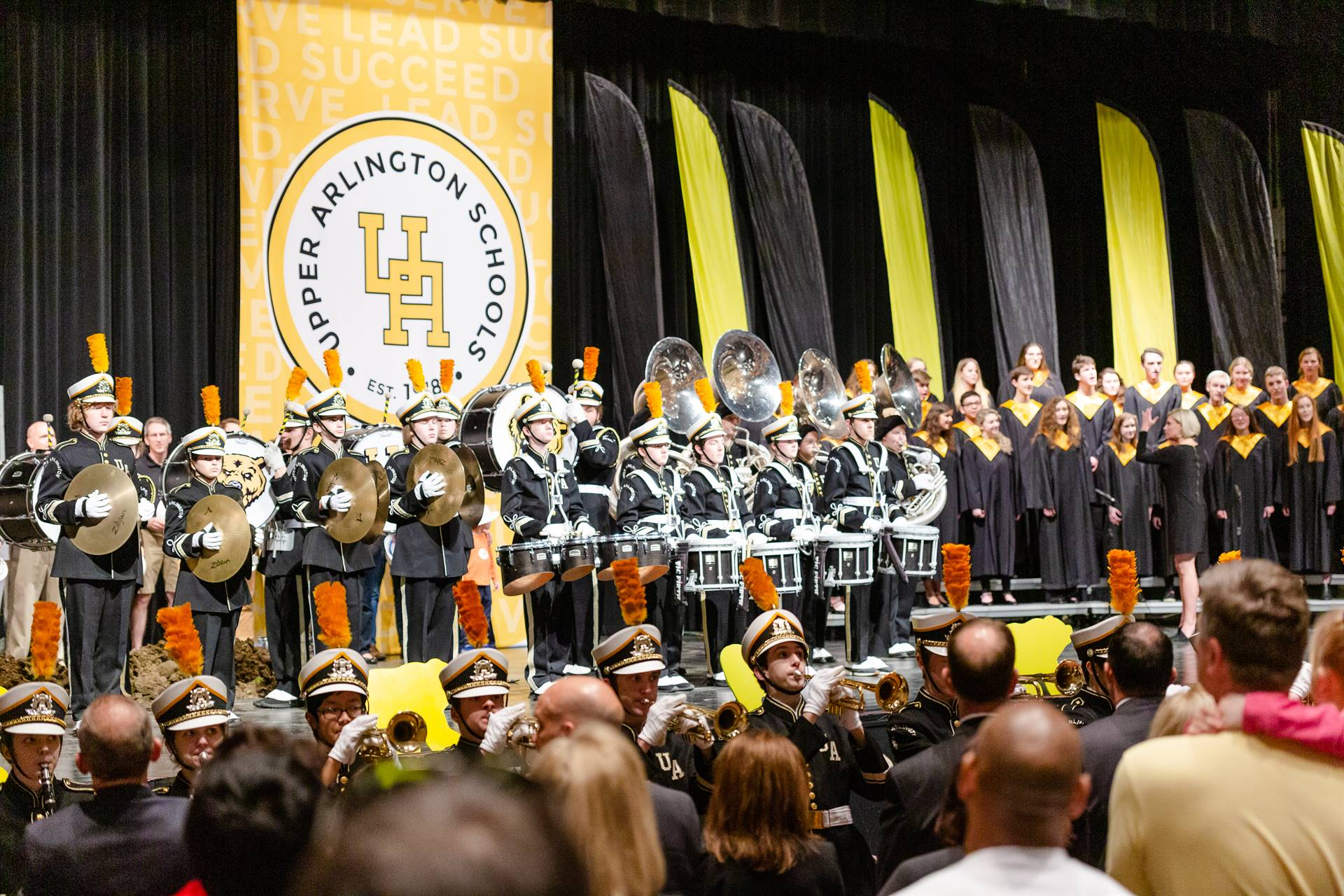 The marching band and choir performing