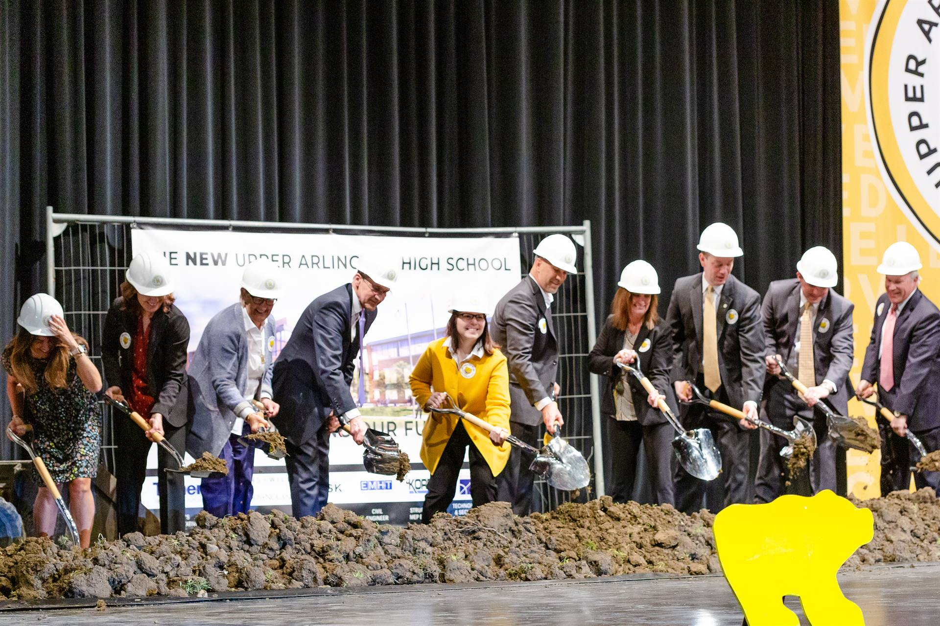 The Board of Education and Upper Arlington Schools administration breaking ground