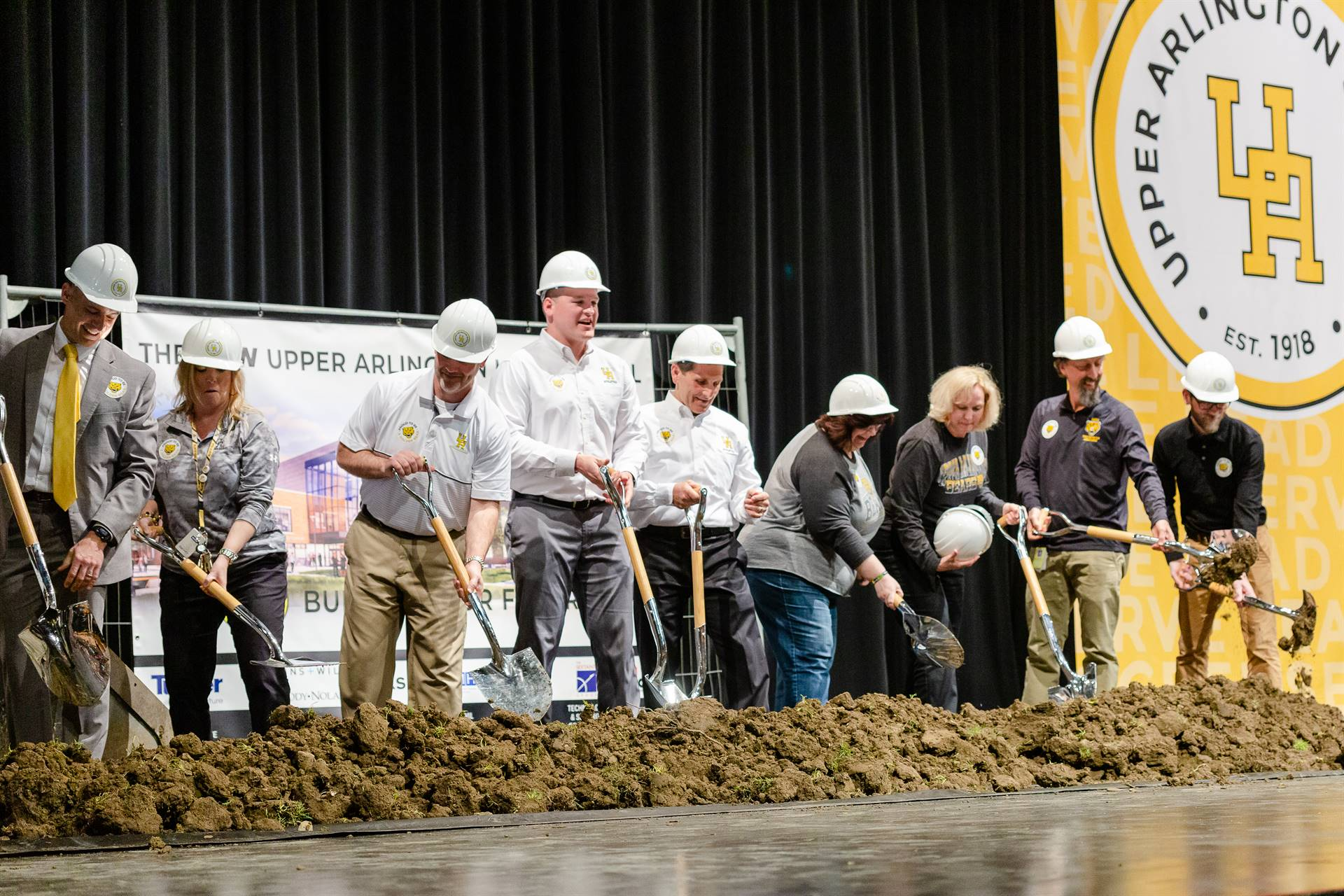 The high school administration and union representatives breaking ground