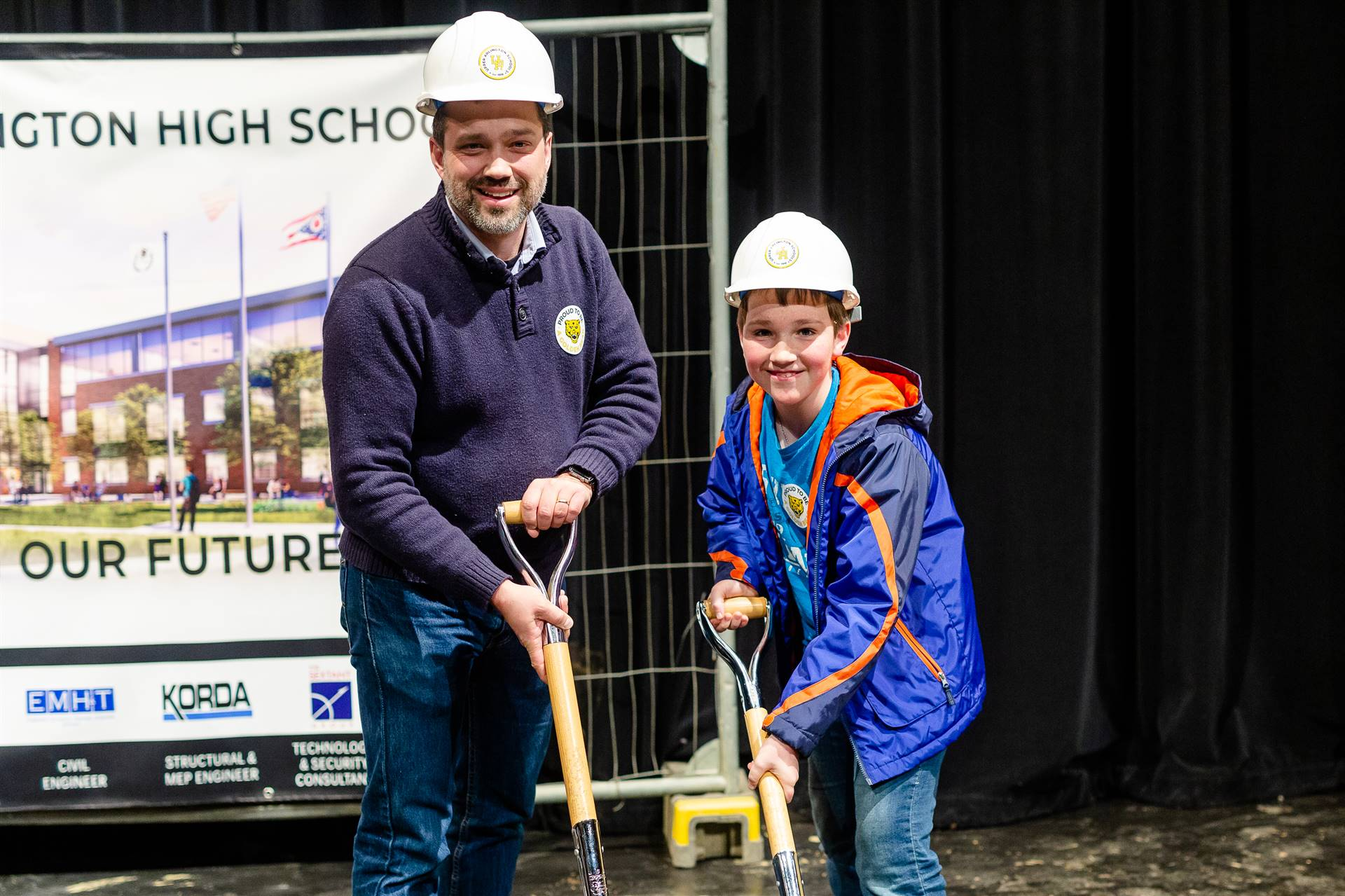 A man and a boy breaking ground