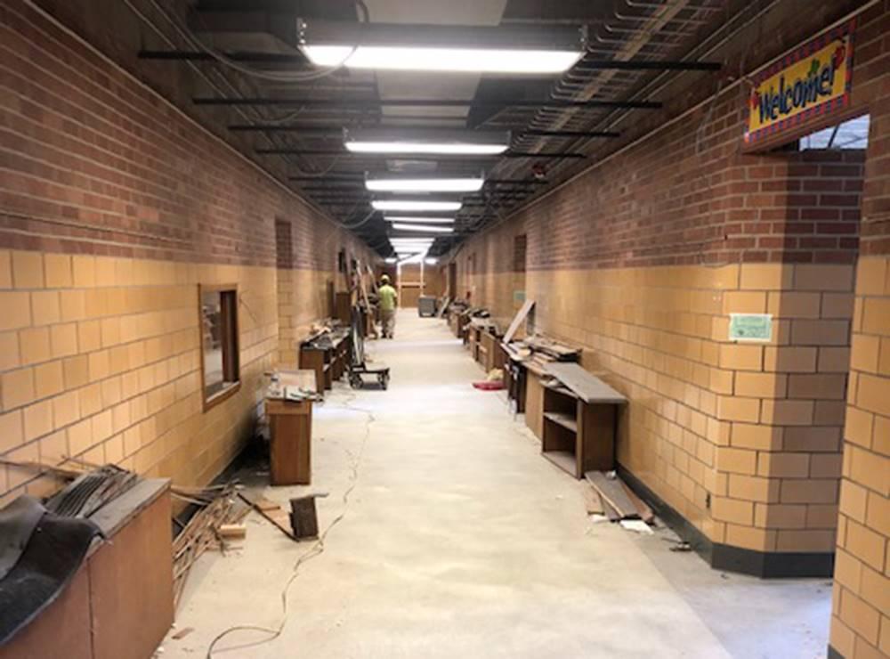 Interior demolition in a hallway at Tremont