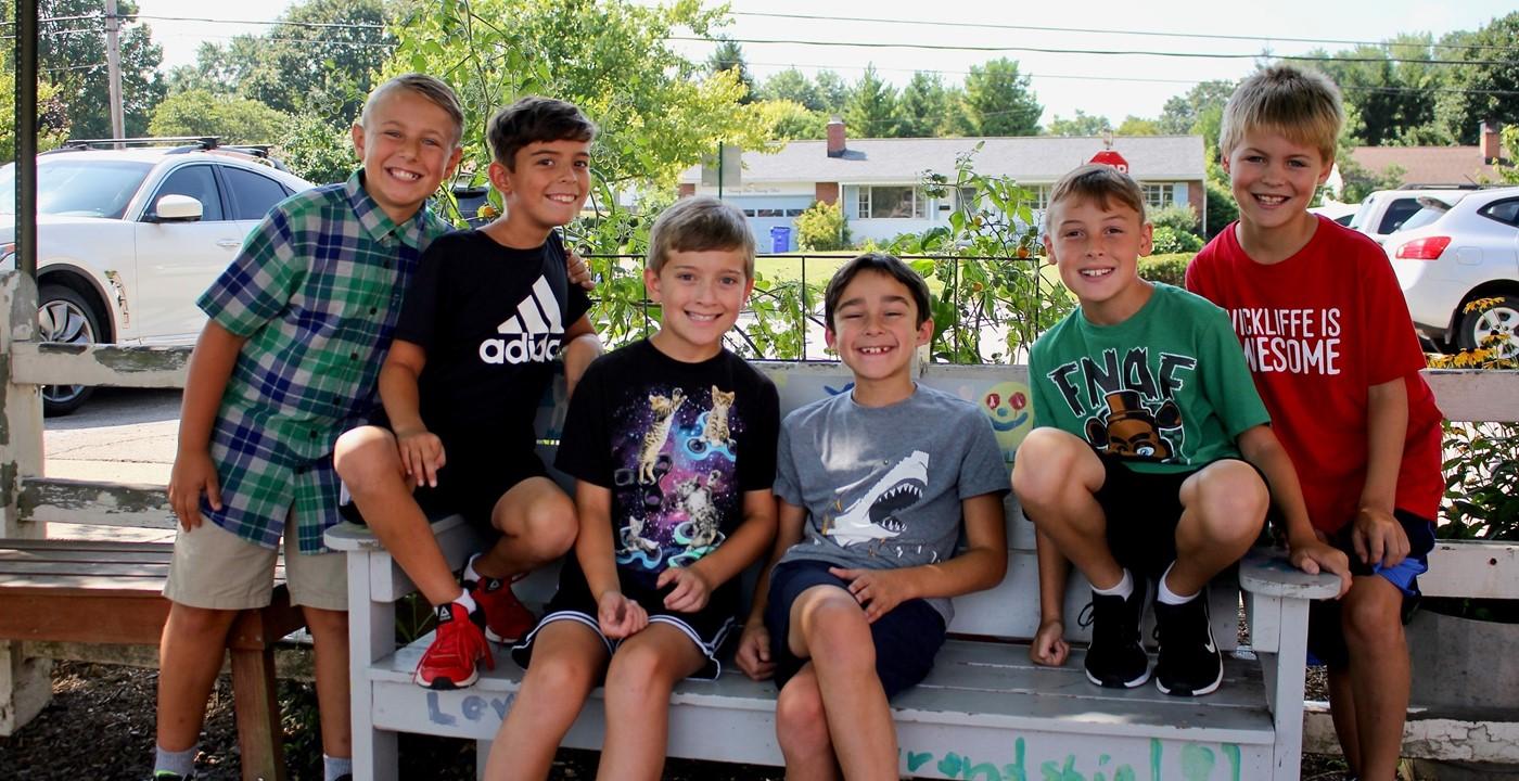 Six boys on a buddy bench
