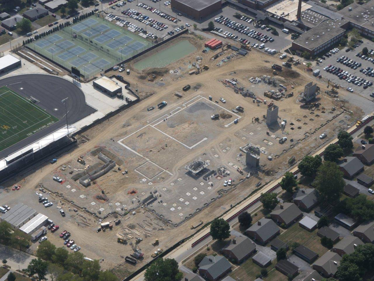 An aerial looking southeast at the site of the new high school building