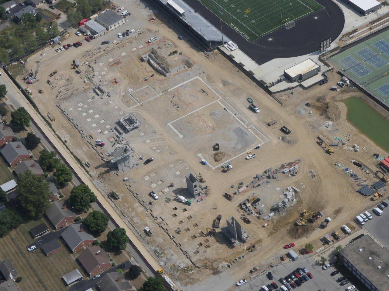 An aerial looking northeast at the site of the new high school building
