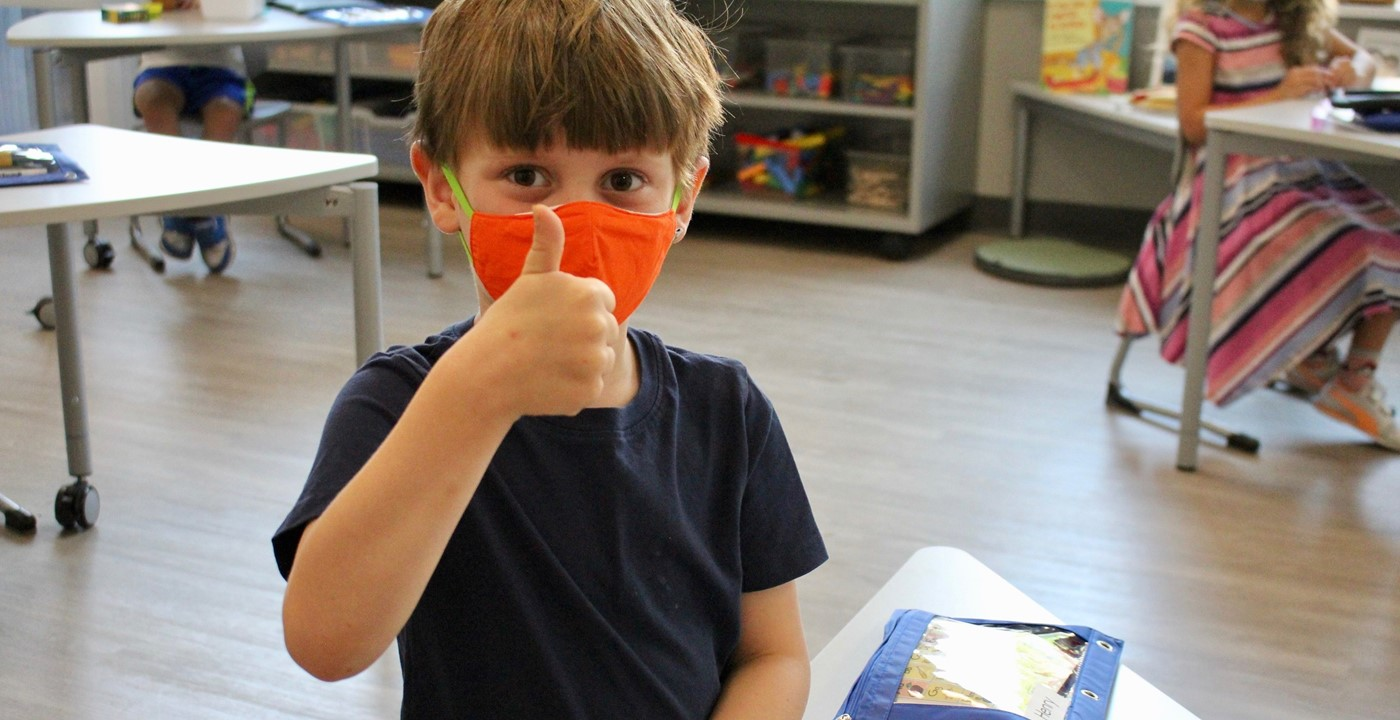A student giving a thumbs up