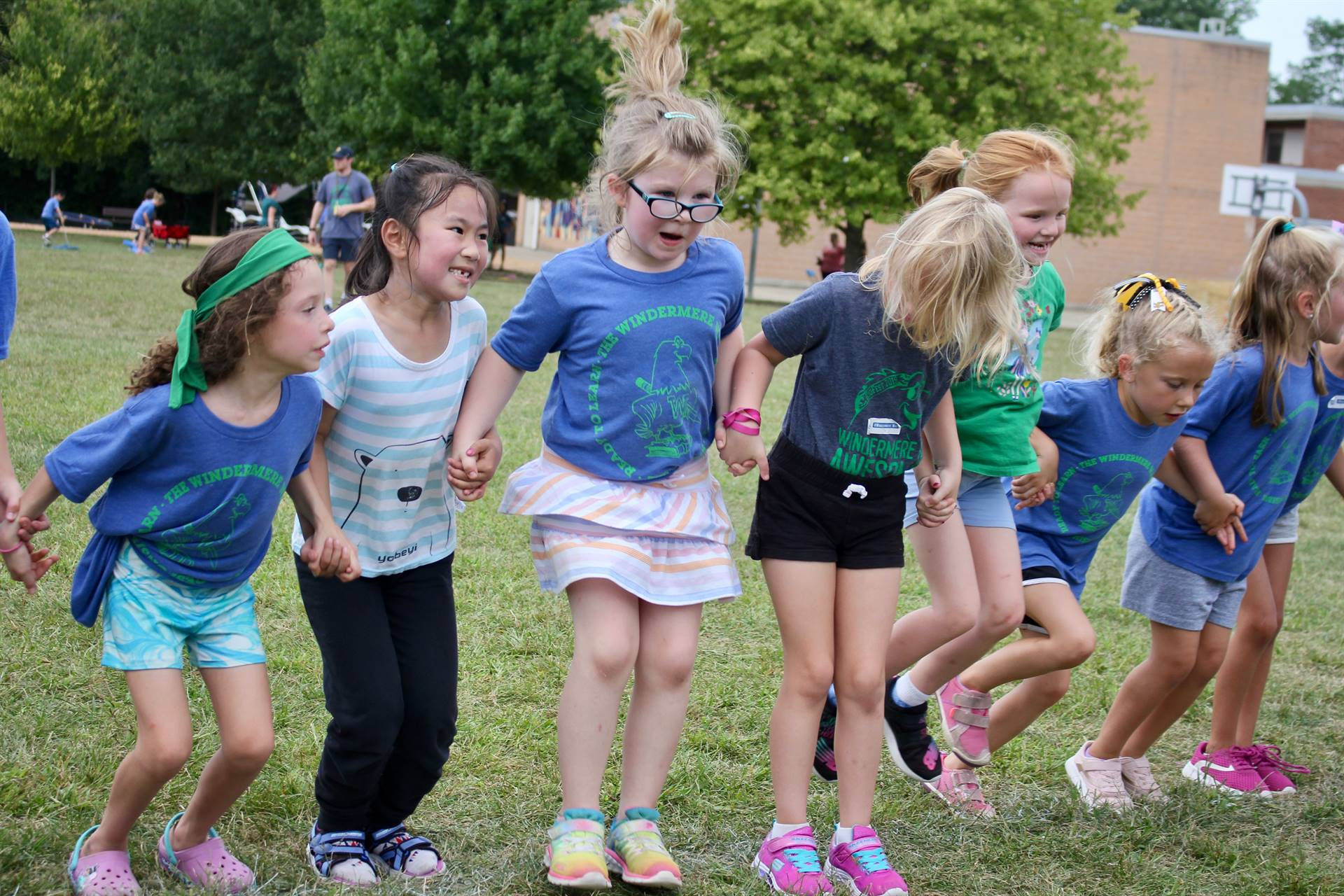 Girls jumping in a line during a field day