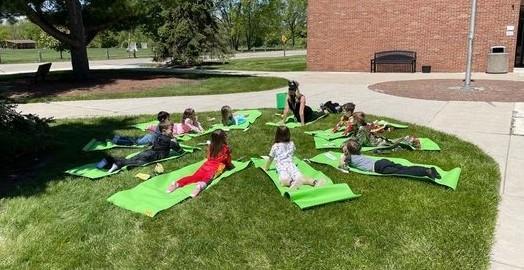 Students doing yoga outside