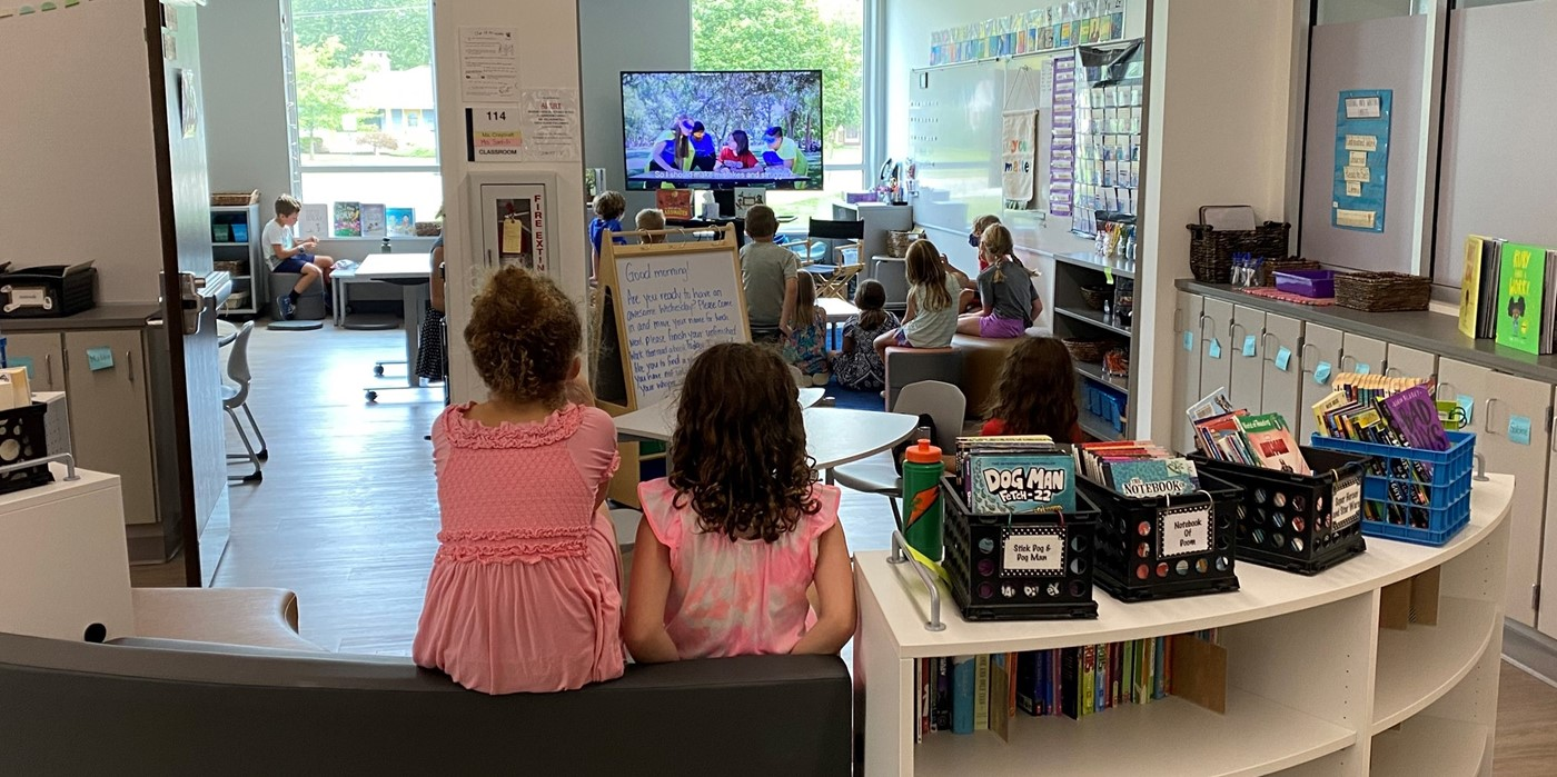 Students watching TV in room
