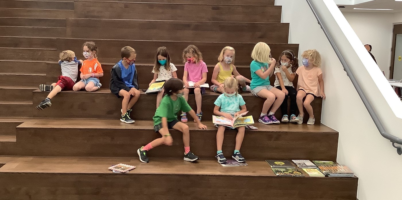 Mrs. Bell's K/1 class on library learning stairs